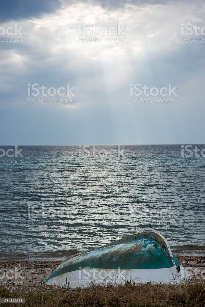 Old boat on land and sea is back stock photo
