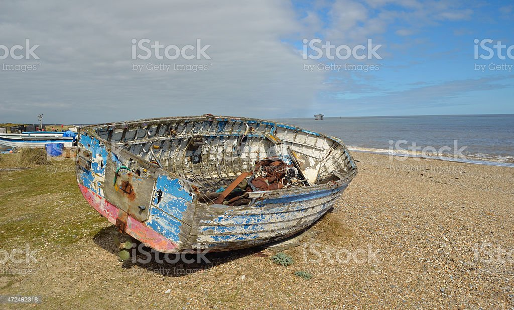 Old boat on Sizewell beach. stock photo