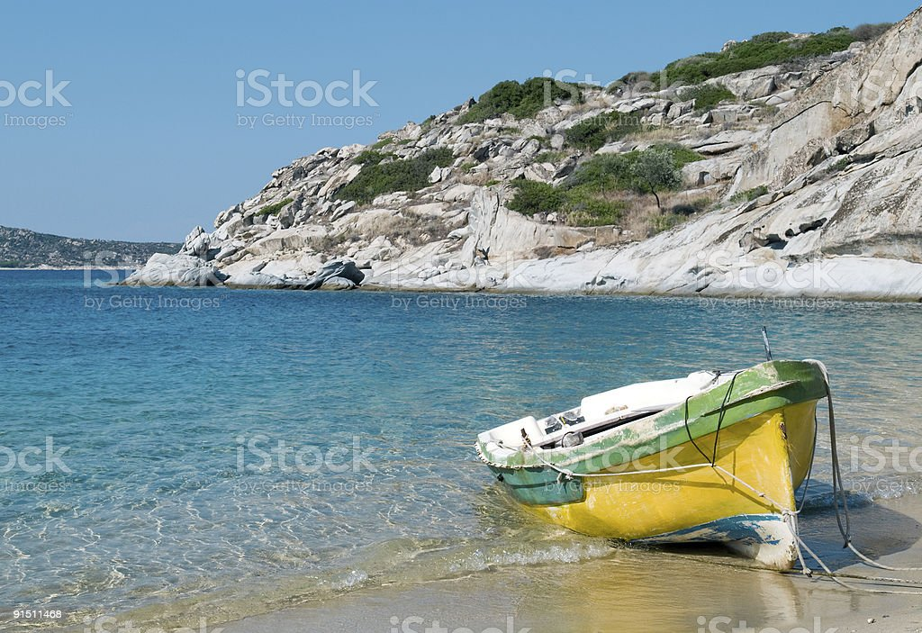 Old boat on the beach - Greek Mediterranean royalty-free stock photo