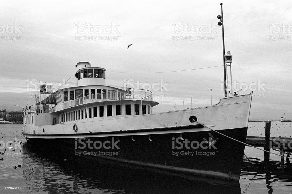 old boat on the Geneva Lake stock photo