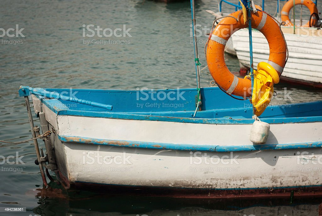 old boat with a lifeline royalty-free stock photo