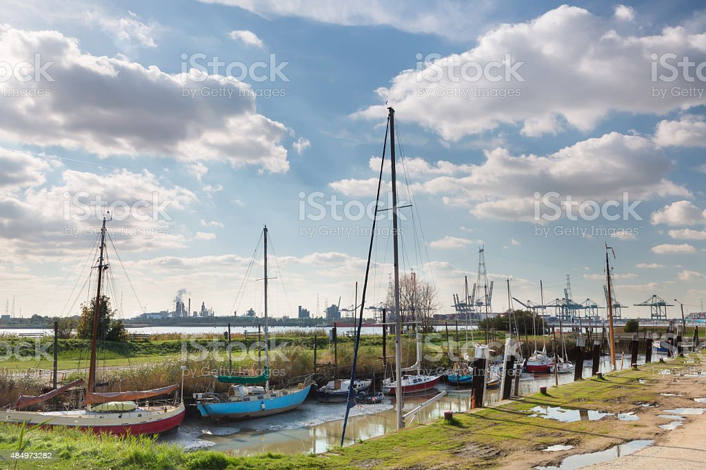 Old boats and modern harbor stock photo