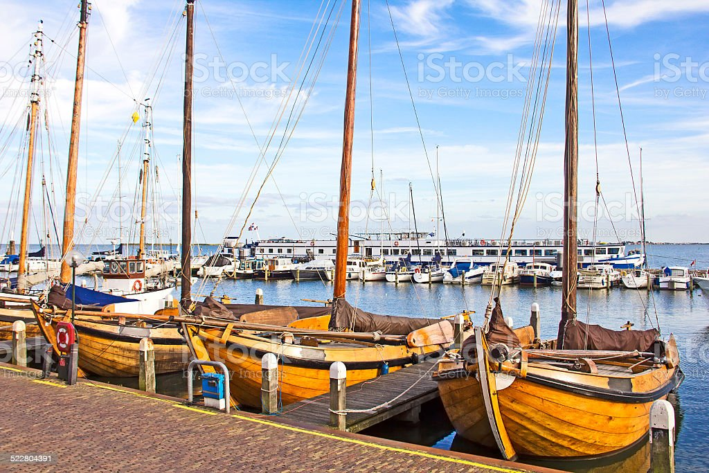 Old boats in the port of Volendam, The Netherlands stock photo