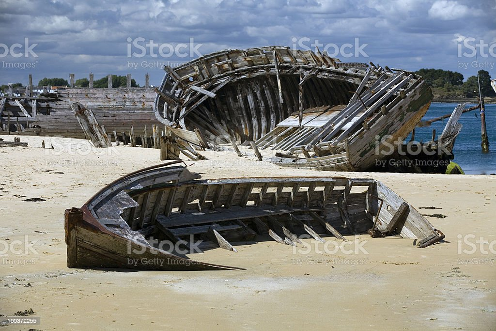 Old boats sun-bleached on sand. stock photo