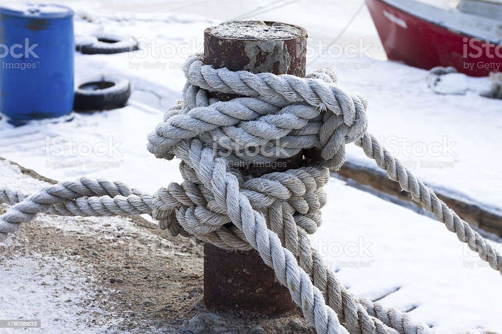 old bollard and frozen ship cable royalty-free stock photo