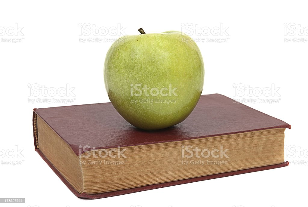 old book and green apple royalty-free stock photo