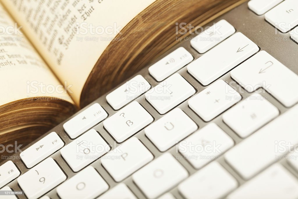 Old Book and Keyboard royalty-free stock photo