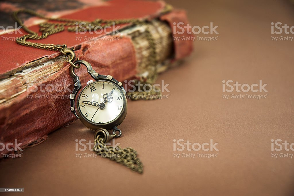 Old Book and Retro Watch royalty-free stock photo