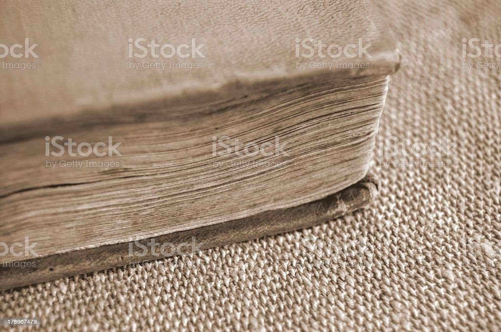 Old book in sepia on burlap royalty-free stock photo
