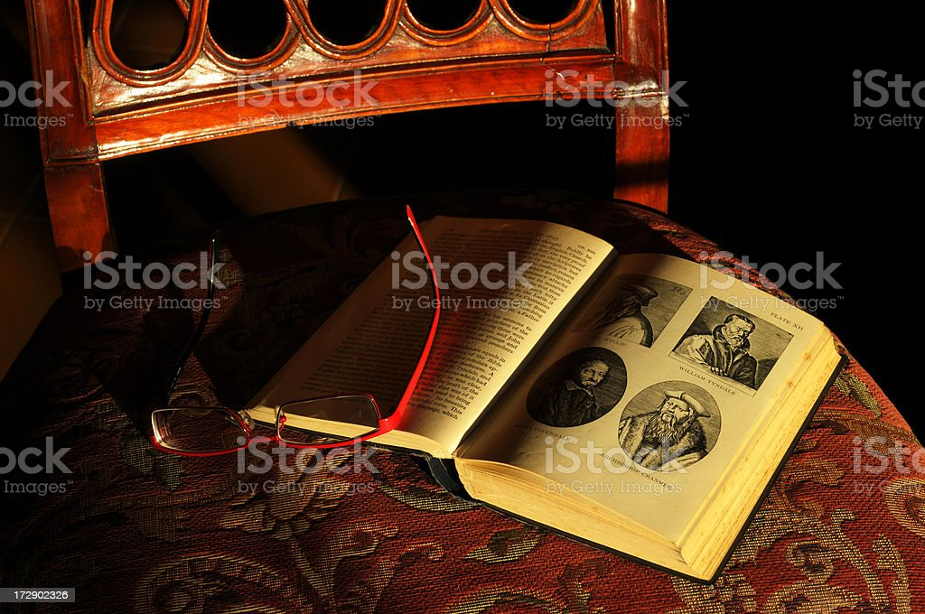 Old book on a chair in the sunset light royalty-free stock photo