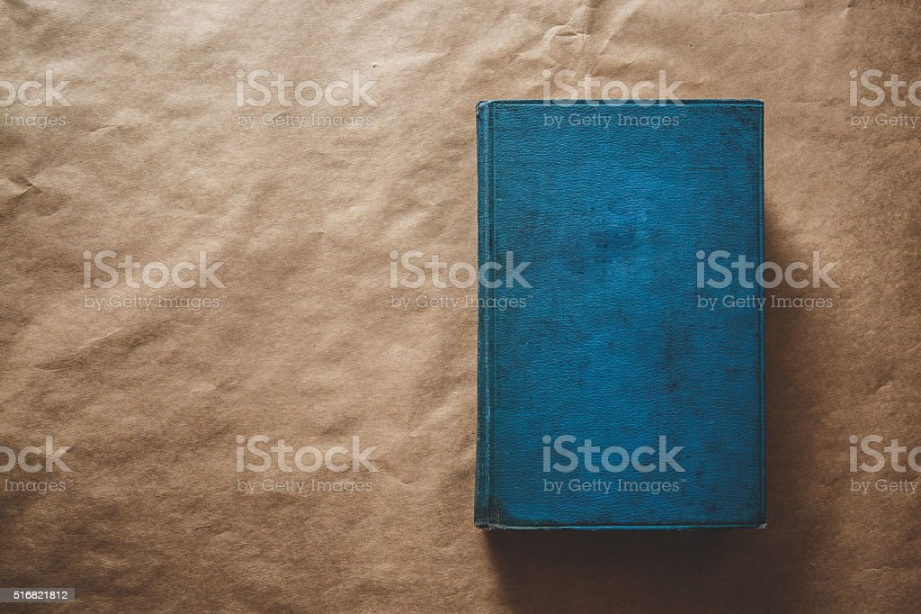 Old book on kraft paper stock photo