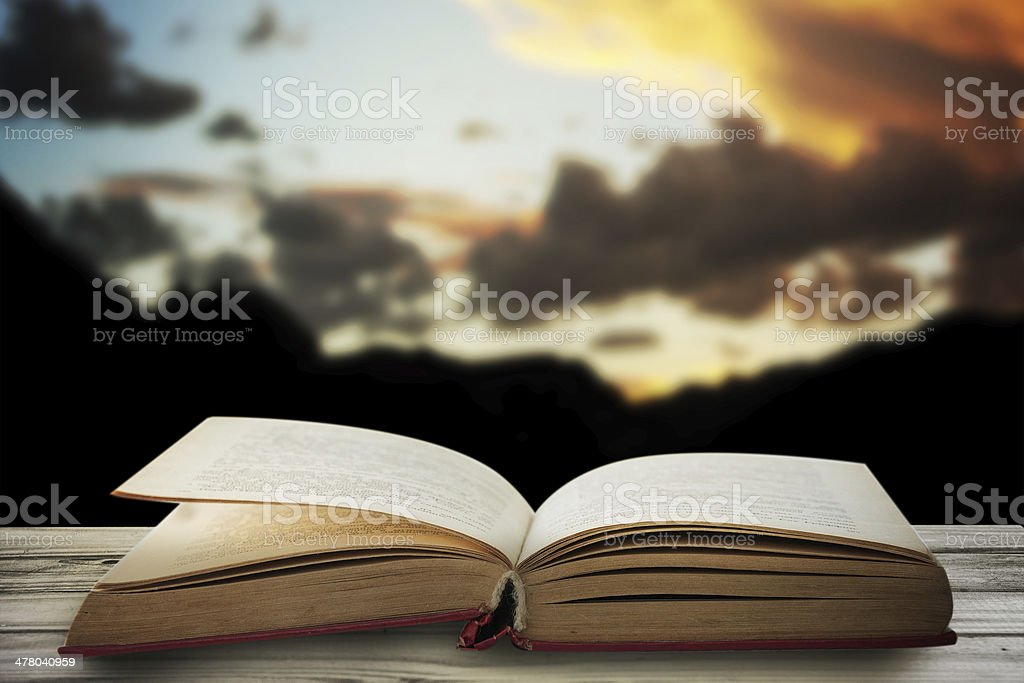 Old book on the wooden terrace royalty-free stock photo
