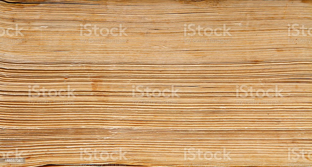 old book paper background, macro of spine pages folded stack stock photo