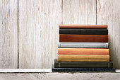 old book shelf blank spines cover, wood texture background, knowledge