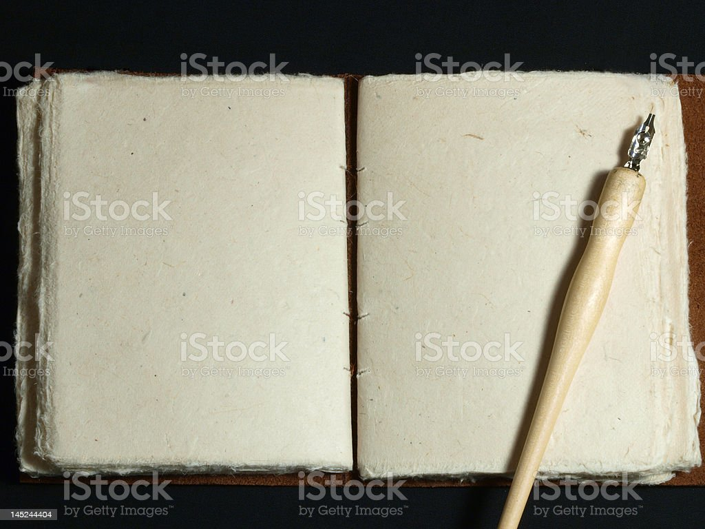 Old Book with Blank Pages and Fountain Pen royalty-free stock photo