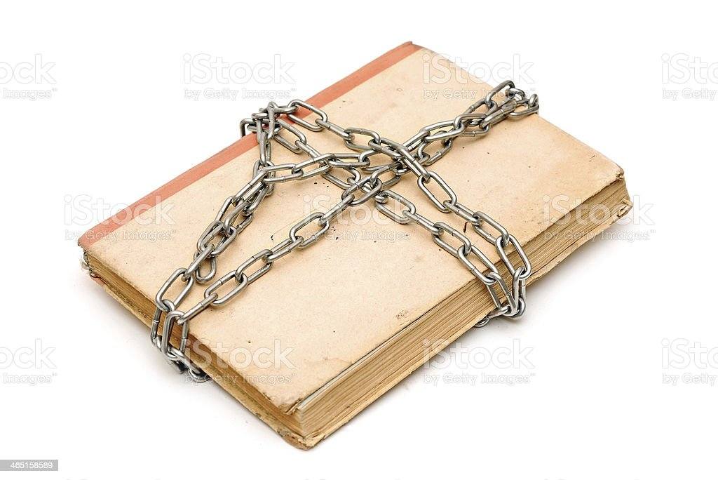 old book with chain isolated on white background royalty-free stock photo