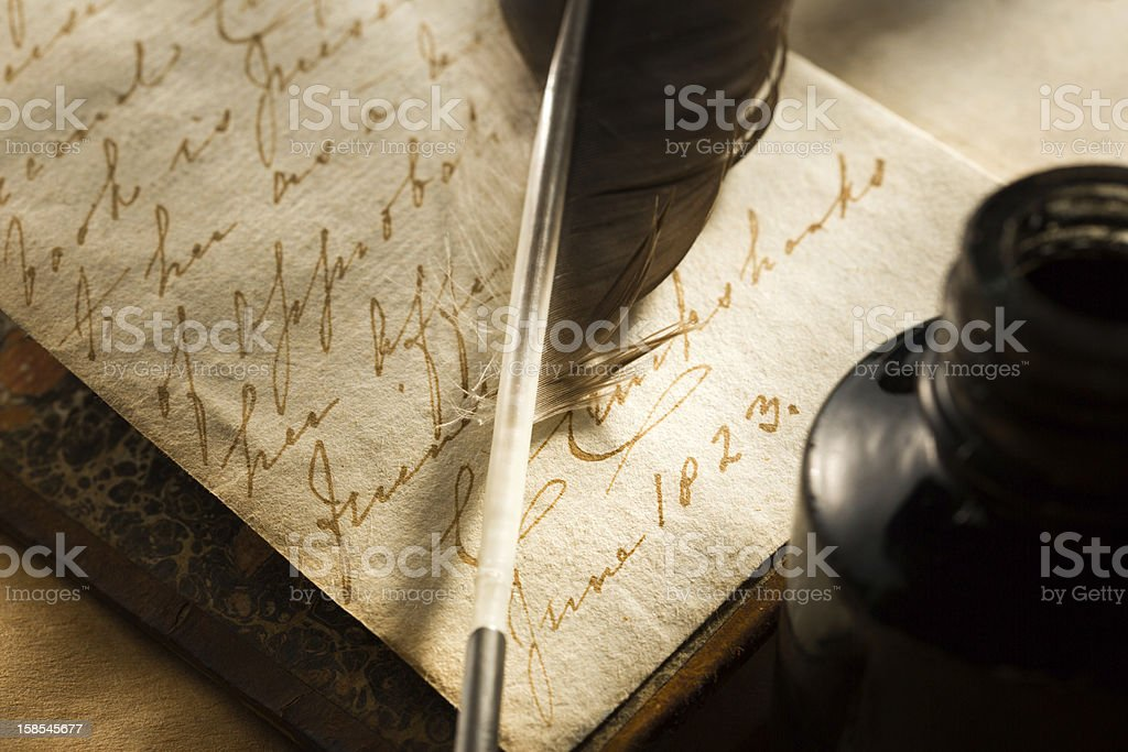 Old book with feather and inkpot royalty-free stock photo