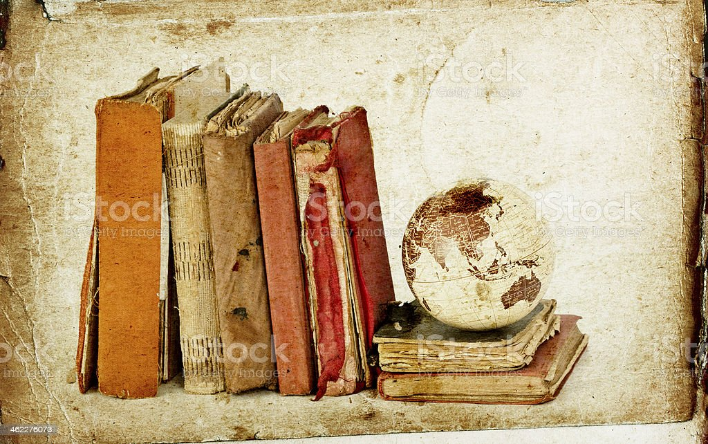 Old books and Earth globe stock photo