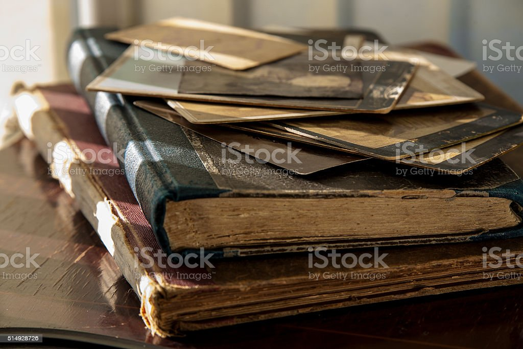 Old books and photos. stock photo