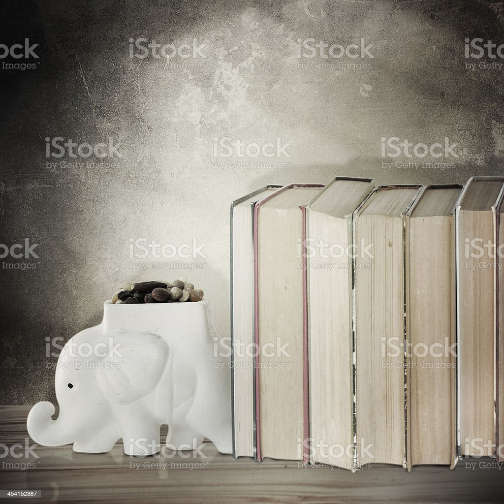 Old books held up with elephant  bookends stock photo
