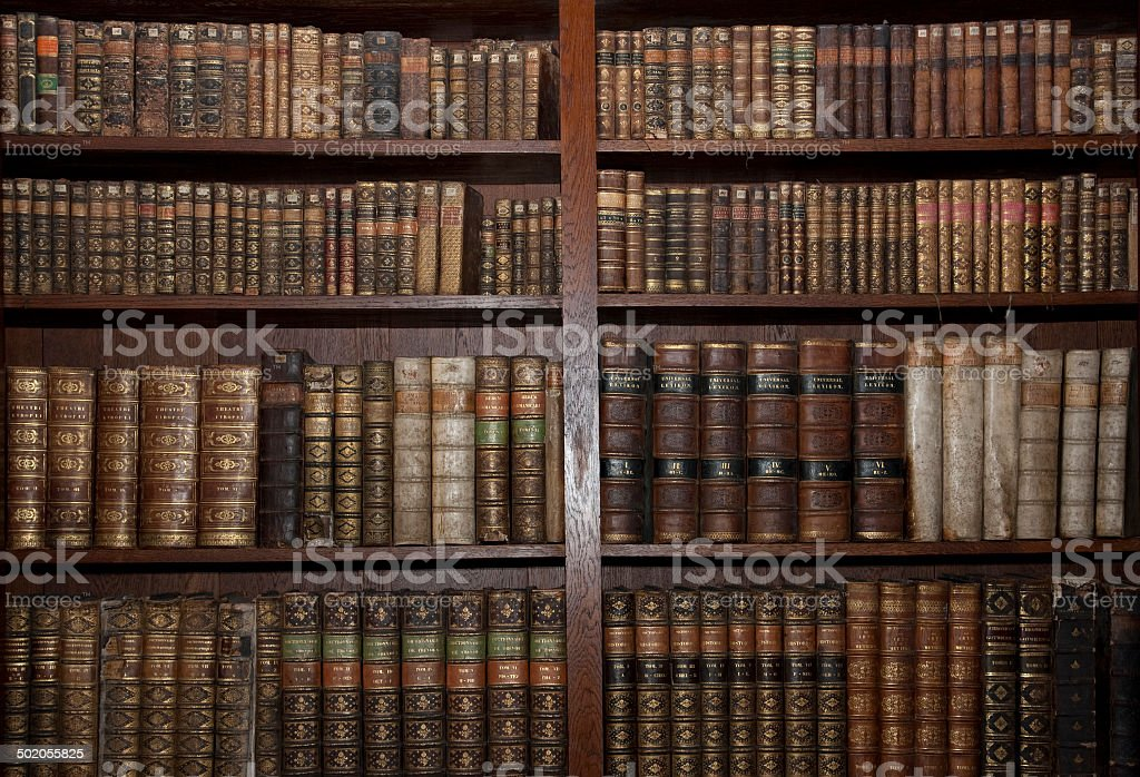 old books in old library stock photo