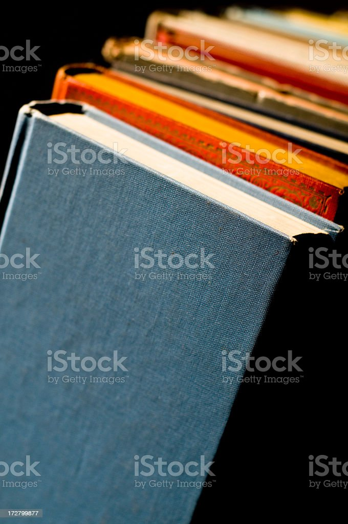 Old books in the spotlit royalty-free stock photo