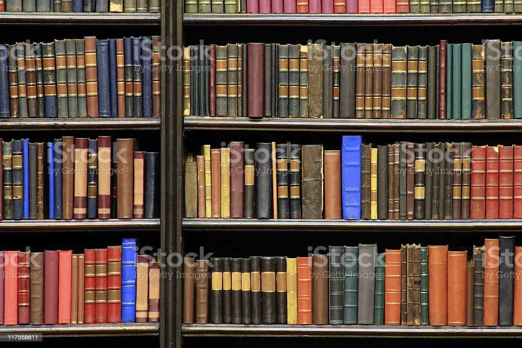 Old books on a library royalty-free stock photo