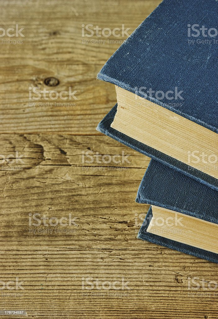 Old books on a wooden shelf royalty-free stock photo