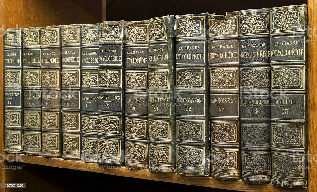 Old books on shelf. French encyclopedia