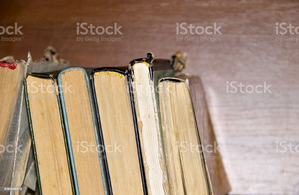Old books on wooden background stock photo