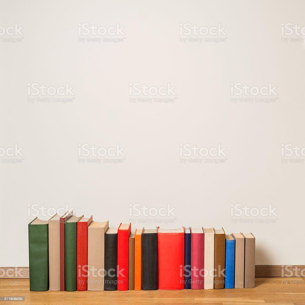 Old books on wooden floor stock photo