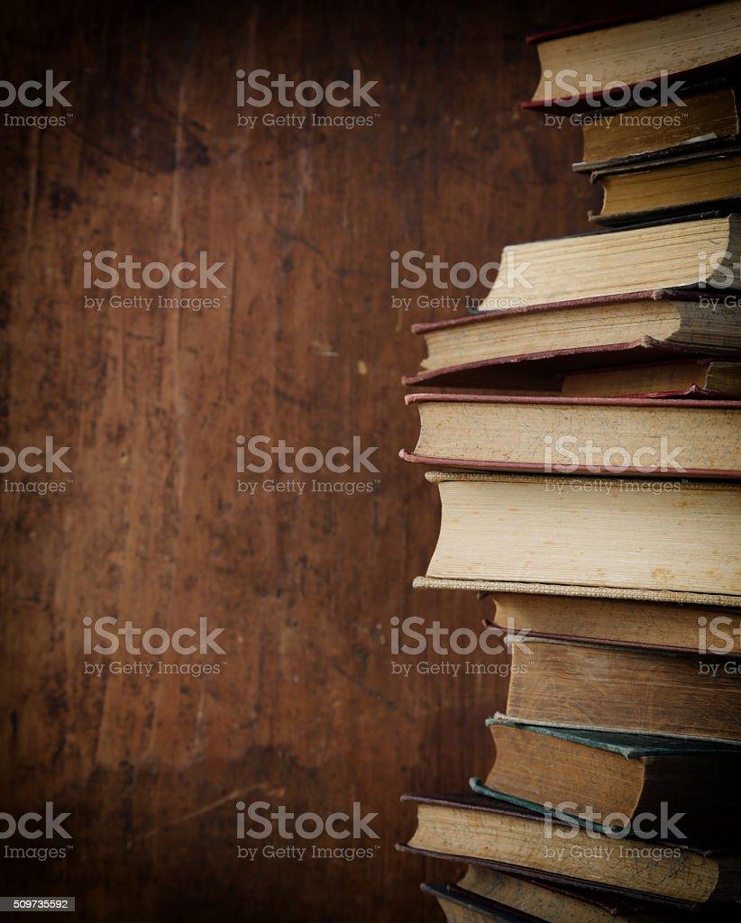 old books on wooden shelf. stock photo