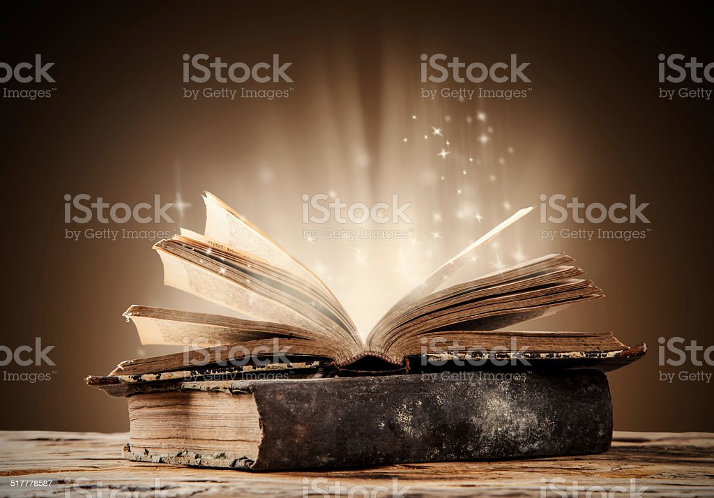 Old books on wooden table stock photo
