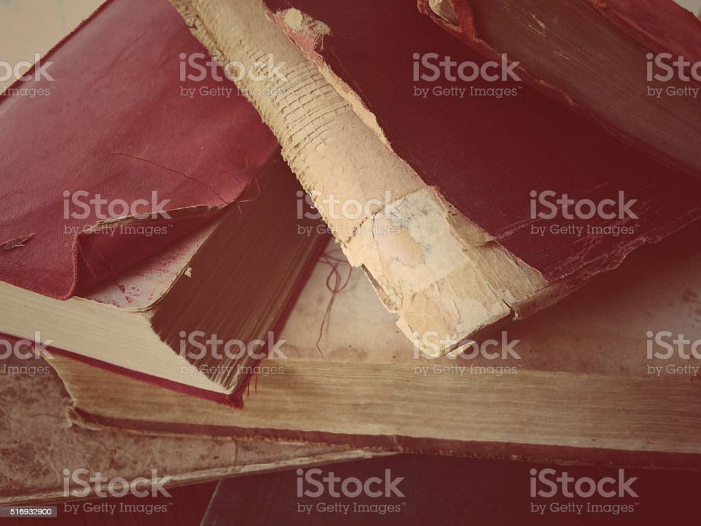 Old books with damaged parts stock photo