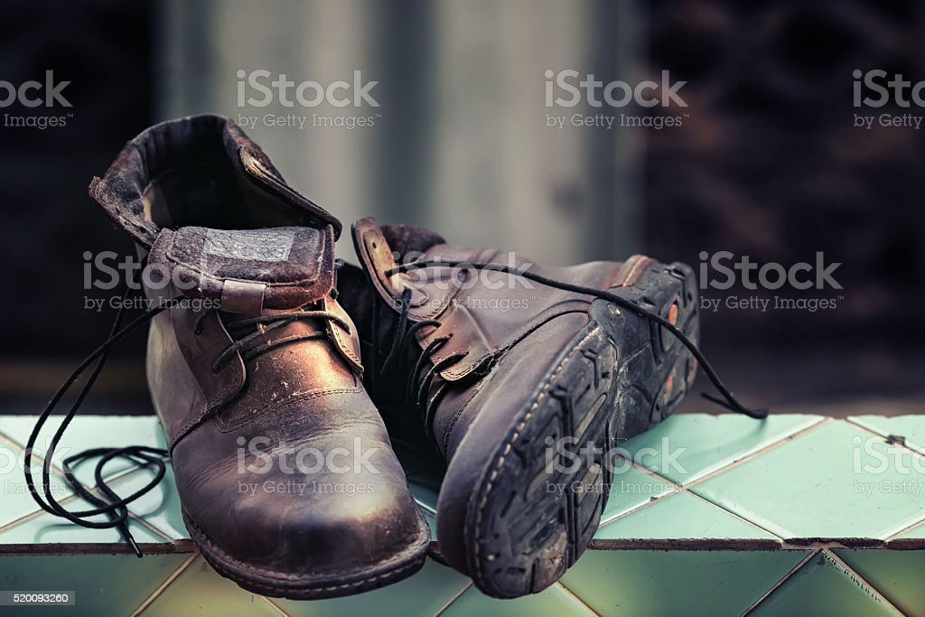 old boots and lighting dramatic stock photo