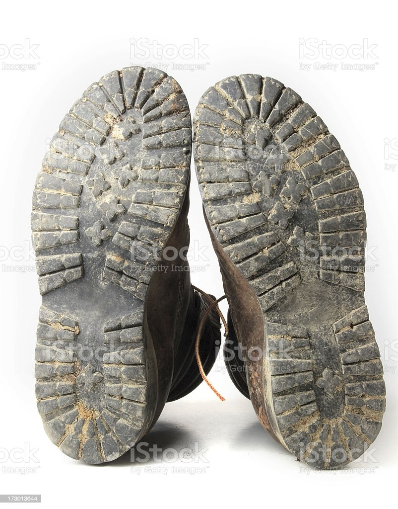 Old boots with many miles on the soles royalty-free stock photo