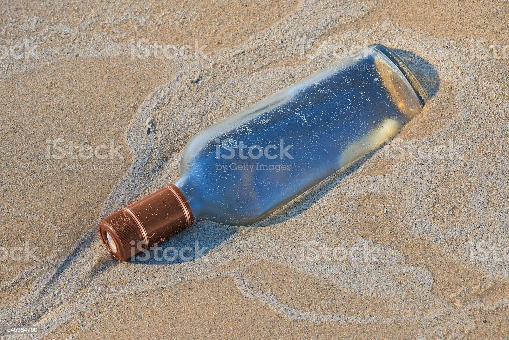 Old bottle washed up on the shore. stock photo