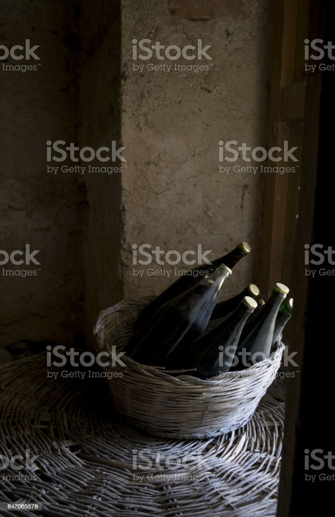 old bottles of red wine on a window stock photo