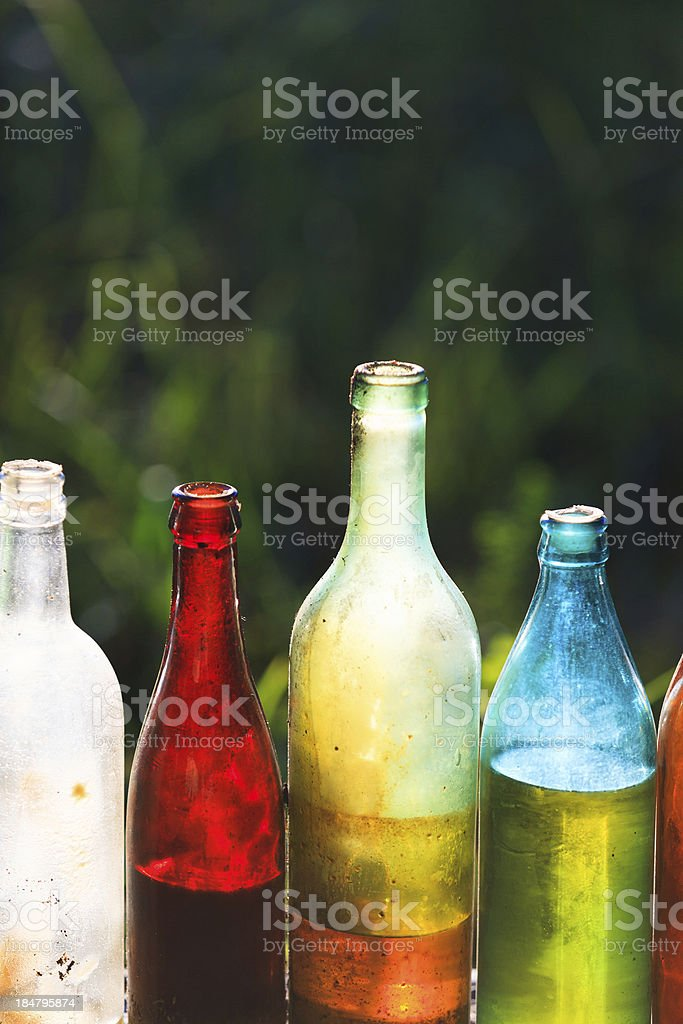 Old bottles of various drinks royalty-free stock photo