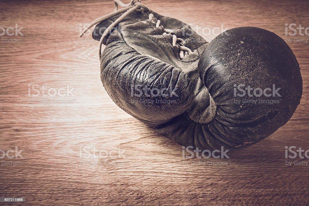 Old boxing glove. Retired champion. Nostalgia.. no need anymore.. stock photo