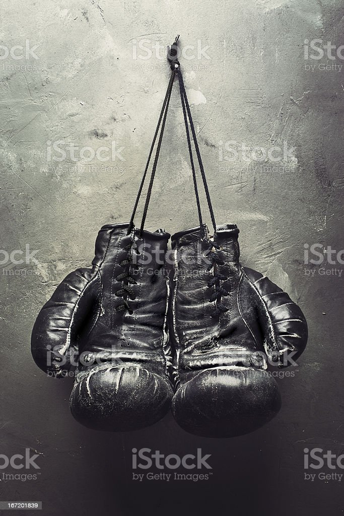 old boxing gloves hang on nail stock photo
