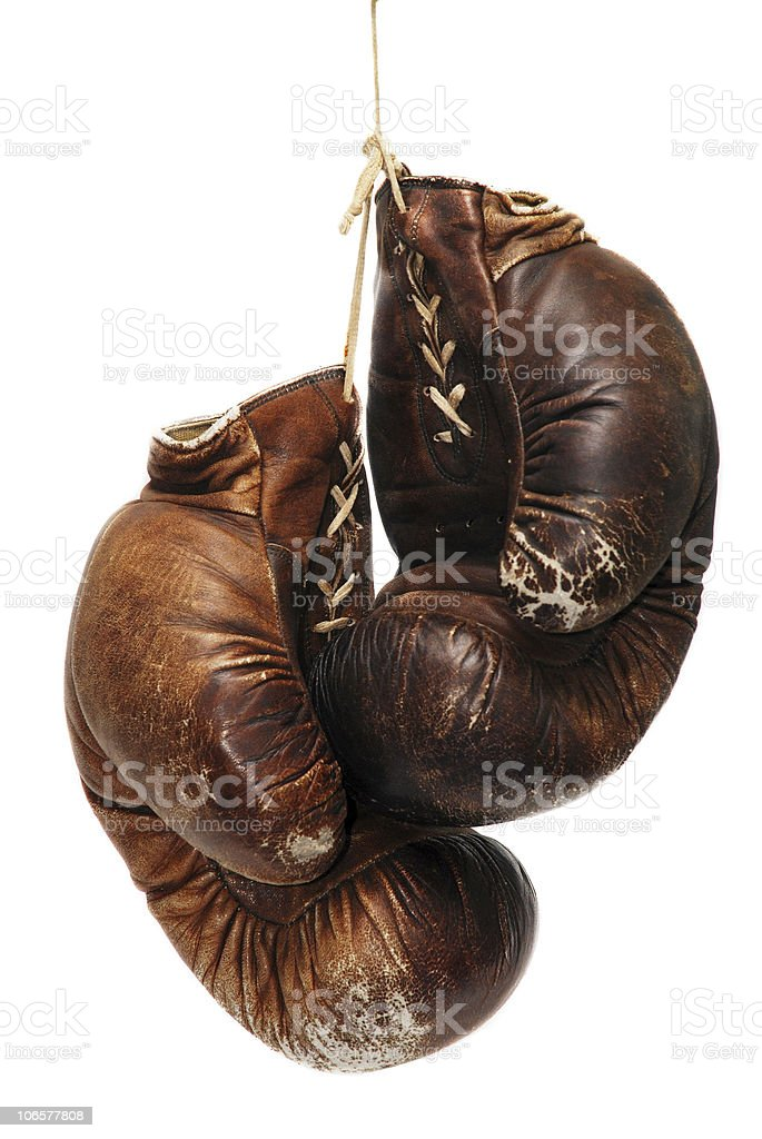 old boxing gloves isolated over white stock photo