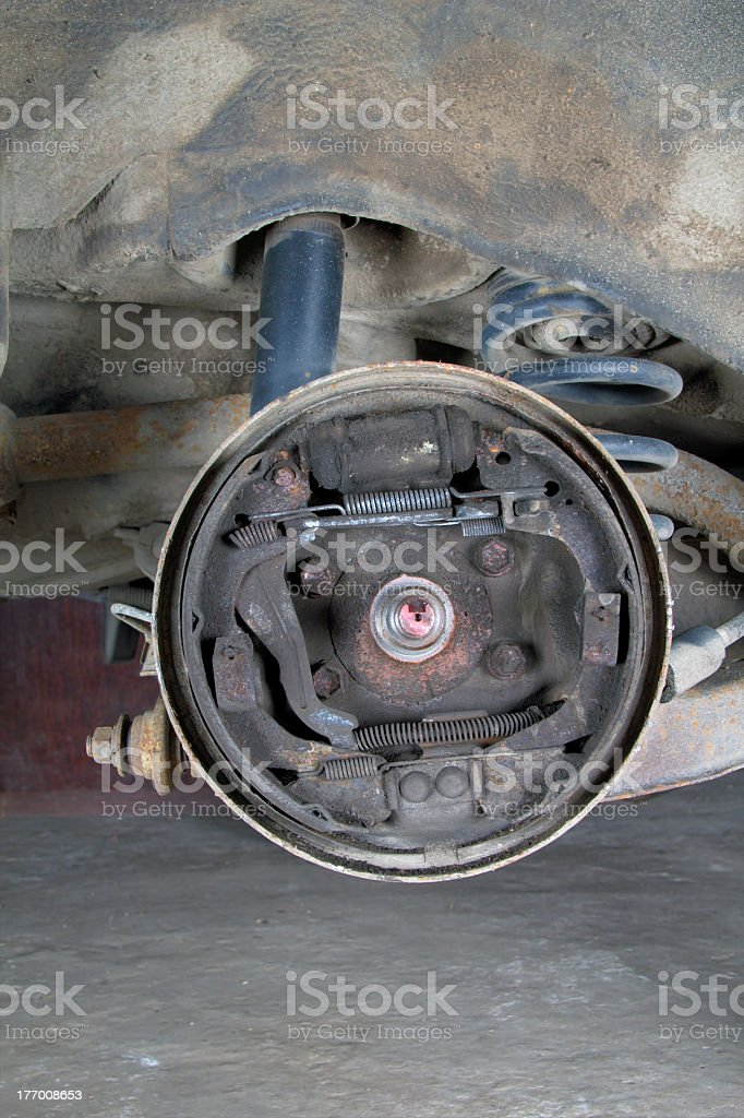 Old brake pads and cylinder royalty-free stock photo