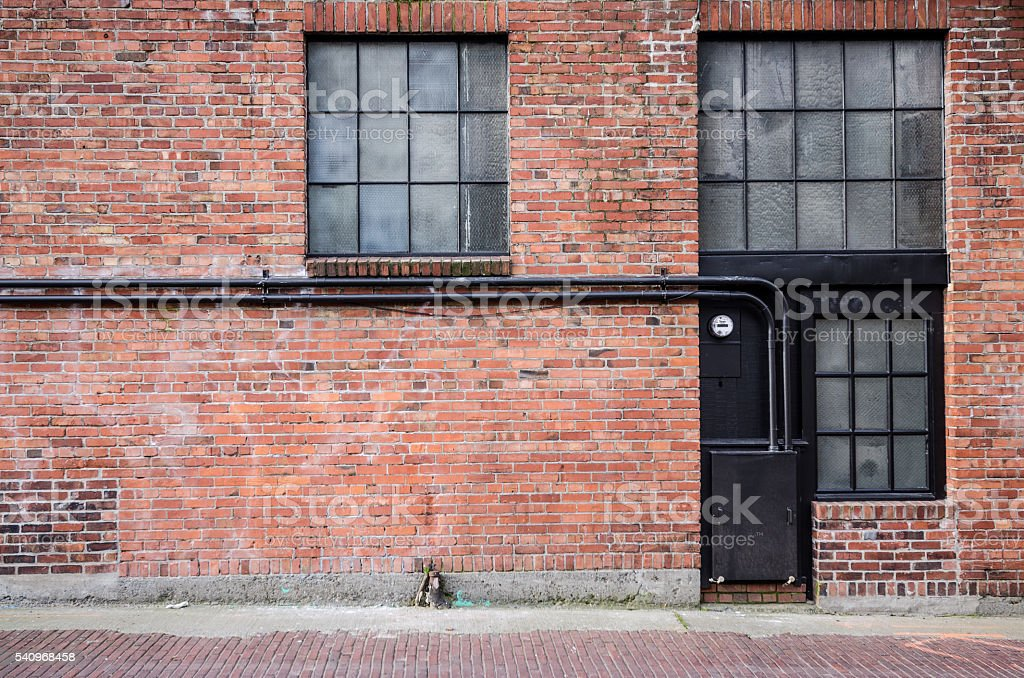 Old brick alleyway with windows stock photo