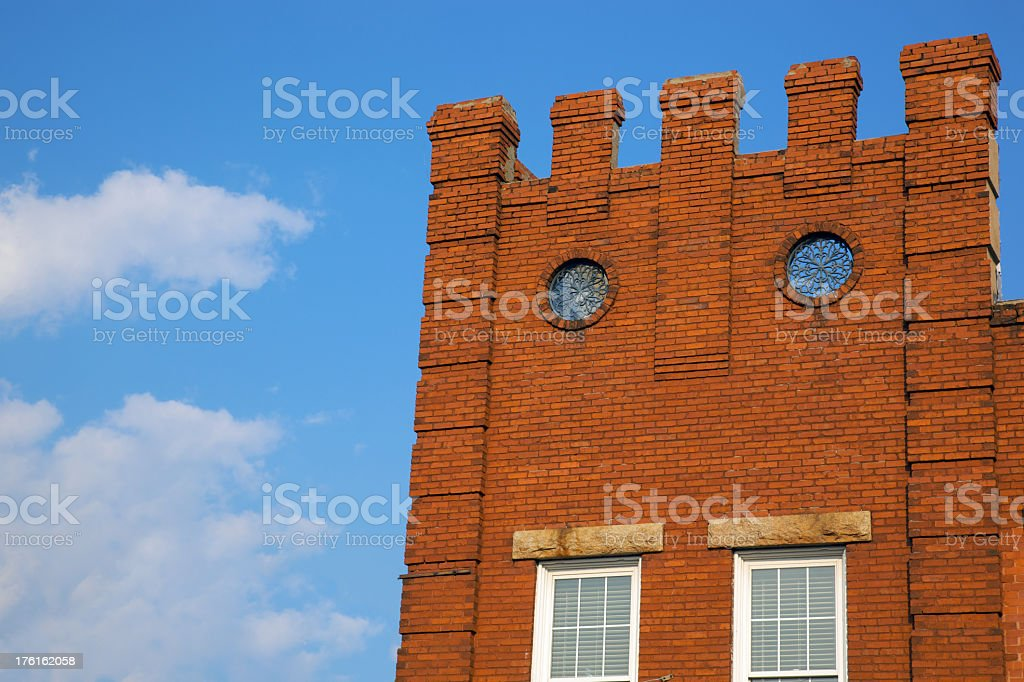 Old Brick Battlement Wall and Rose Windows stock photo