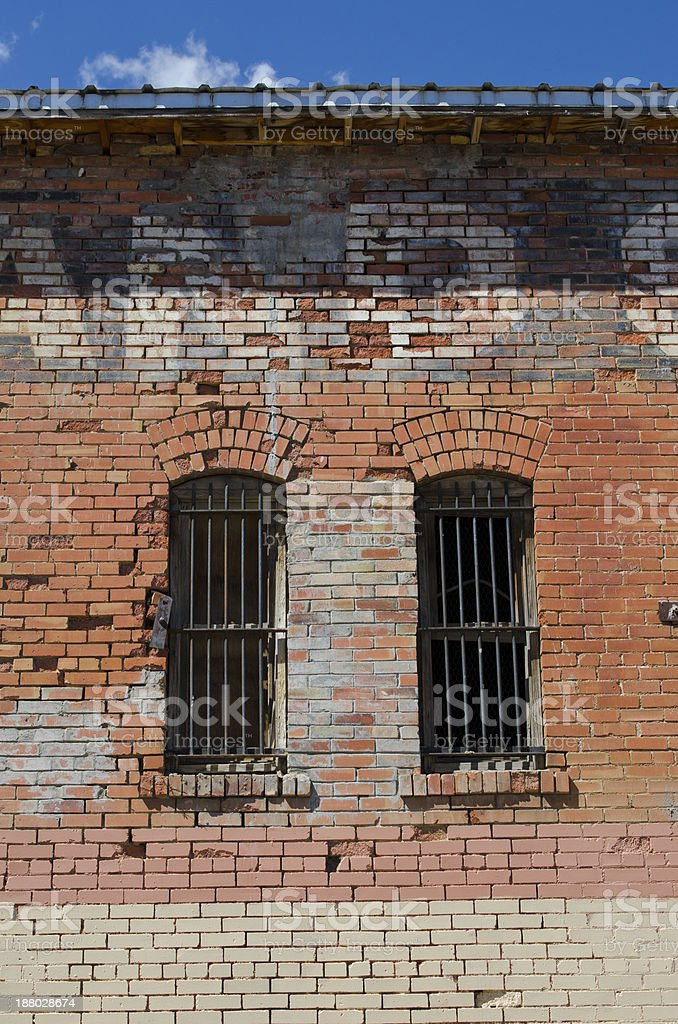 Old Brick Building with Barred Windows stock photo