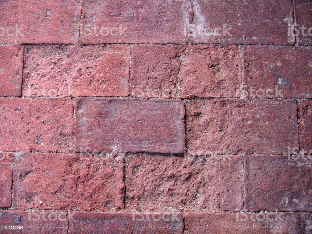 Old brick floor very spoiled stock photo