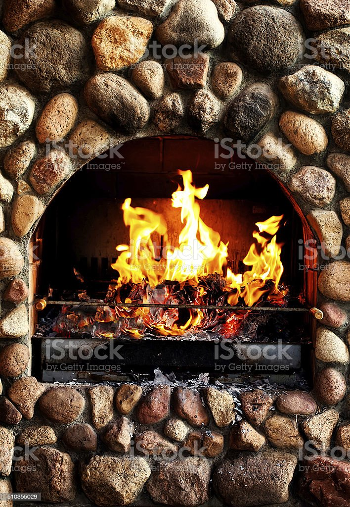 old brick stove with glowing fire stock photo