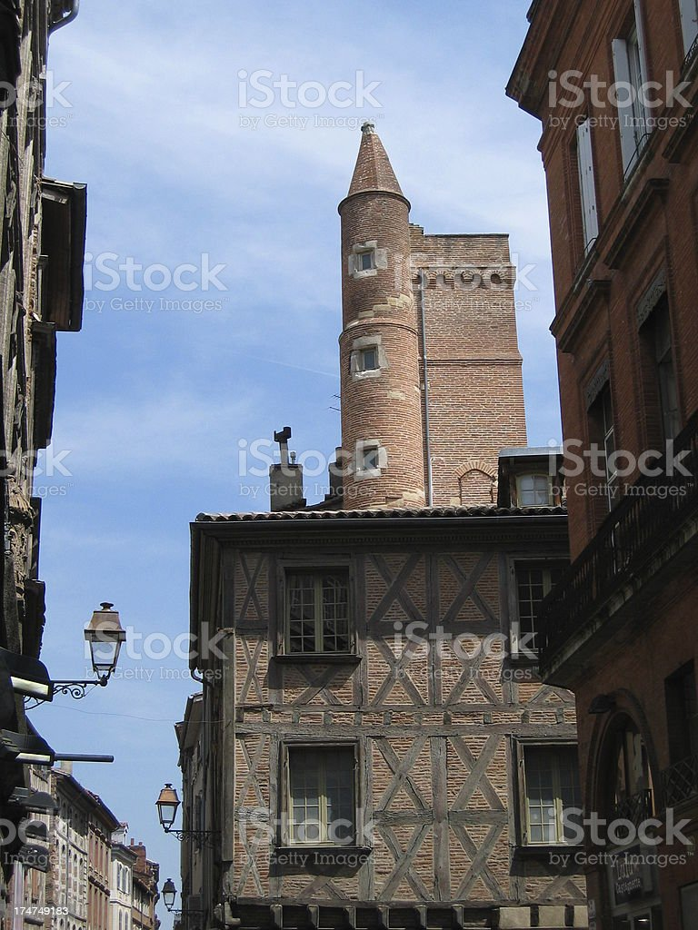 Old brick tower in the center of Toulouse royalty-free stock photo