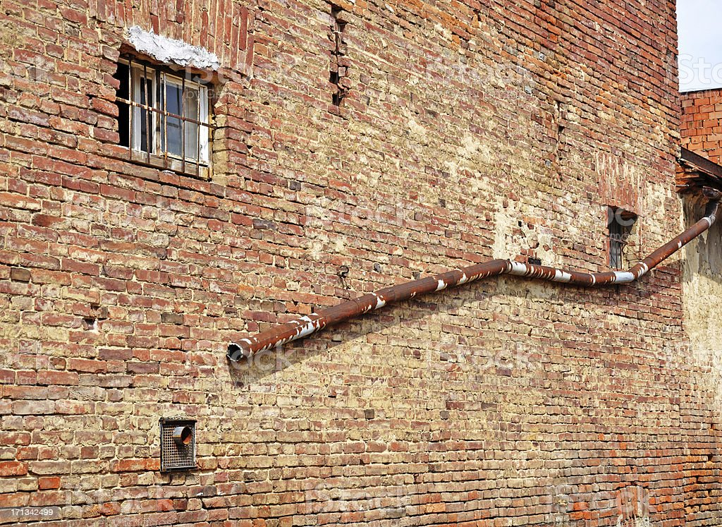 old brick wall and pipe stock photo